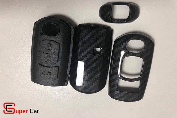 Bao da chìa khóa cacbon cho xe Mazda 2